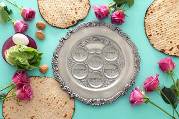 Pesah celebration concept (jewish Passover holiday). Translation for Hebrew Text horseradish, celery, egg, bone, bitter herb, charoset - paste made of fruits
