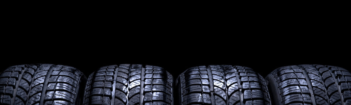 Car tires isolated panorama on black background