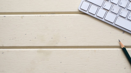 Wall Mural - keyboard and pencil workspace on wood background