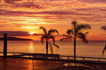 Beautiful and vibrant sunrise over Cote d`Azur and French Riviera of Nice in summertime, France