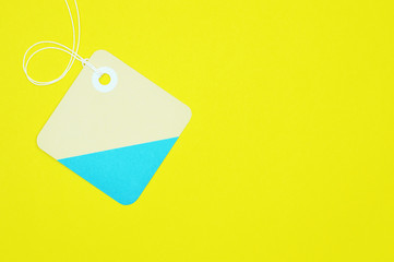 square paper tag on yellow background horizontal template