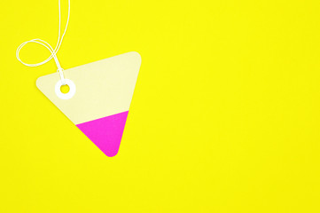 triangle paper tag on yellow background horizontal template