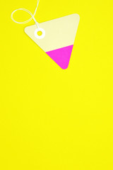 triangle paper tag on yellow background vertical template