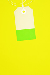 clipped rectangle paper tag on yellow background vertical template