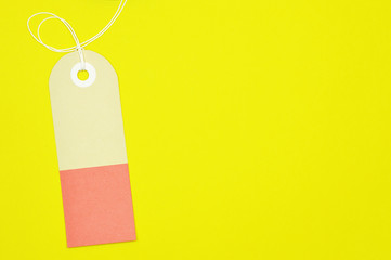 curved rectangle paper tag on yellow background horizontal template