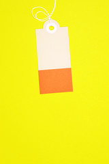 decorated rectangle paper tag on yellow background vertical template