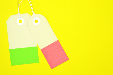 decorated rectangle paper tags on yellow background