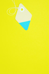 diamond paper tag on yellow background vertical template