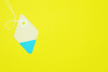 diamond paper tag on yellow background horizontal template