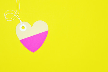 heart paper tag on yellow background horizontal template