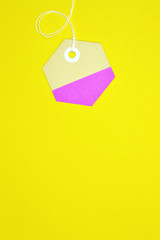 hexagon paper tag on yellow background vertical template