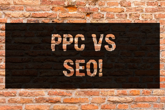 Writing note showing Ppc Vs Seo. Business photo showcasing Pay per click against Search Engine Optimization strategies Brick Wall art like Graffiti motivational call written on the wall