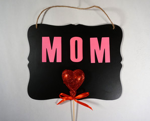 Mom on chalkboard with hearts design for Mother's day