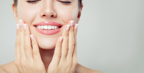 Perfect woman smile and manicured hand. French manicure and pink lipgloss makeup Wall mural