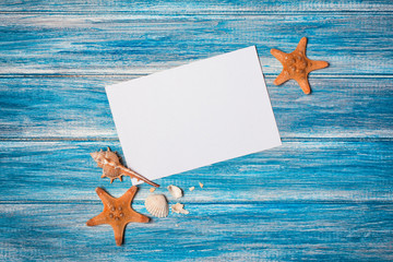 Mockup of white paper card for photo or lettering with starfish and seashells