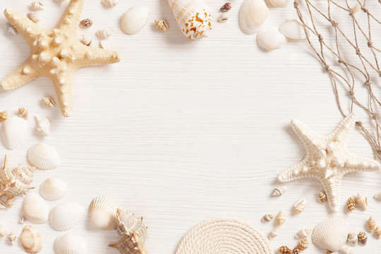 White textured wooden surface decorated with sea shells