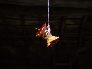 Concept of problems with food. A red apple committing suicide, hanging with a tape measure