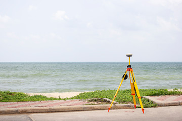 GPS surveying in field sea background, Global Positioning System.