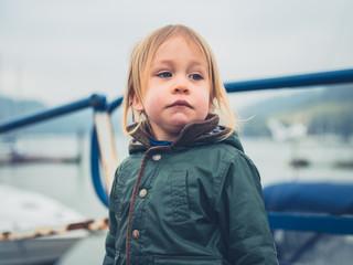 Toddler in boatyard