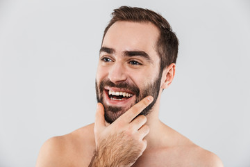 Close up of a young handsome bearded shirtless man