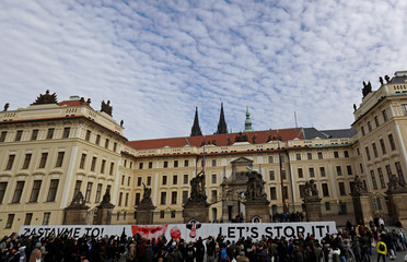 People look at a paper wall made by activists during a flash mob event in Prague