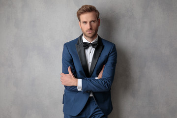 Well dressed man holding his hands crossed