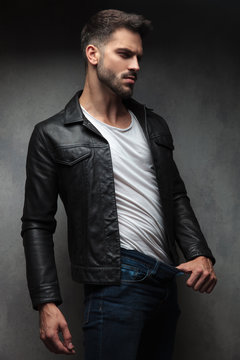 sexy man in leather jacket showing how thin he is