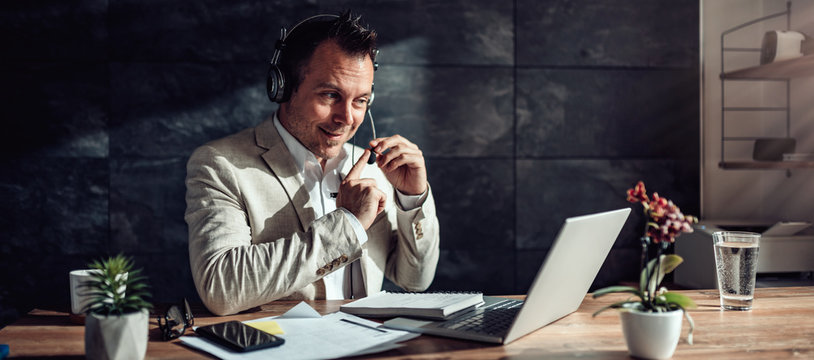 Businessman testing microphone before online meeting