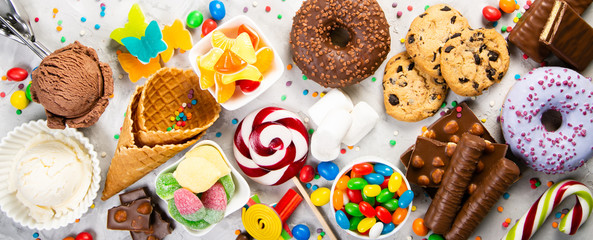 Selection of colorful sweets - chocolate, donuts, cookies, lollipops, ice cream top view Wall mural