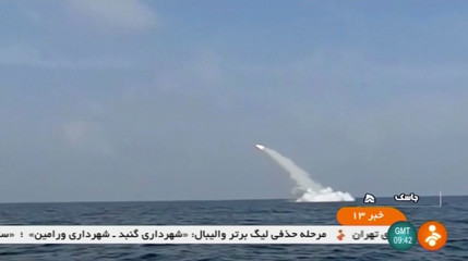 An Iranian cruise missile fires into the air from a submarine during a test at Strait of Hormuz, at the mouth of the Gulf