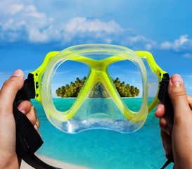 Snorkeling diving mask and tropical island view