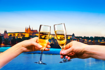 Prague downtown with glasses of champagne, mixed media