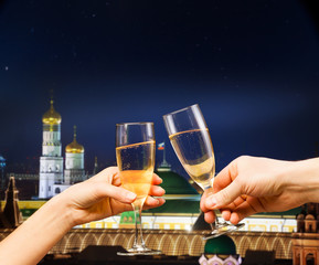 Moscow kremlin with glasses of champagne, mixed media