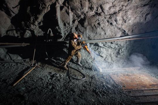 Underground gold ore mine shaft tunnel gallery passage miner drilling