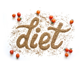 The word diet written in buckwheat on a white background with tomatoes. Poster healthy nutrition and diet.