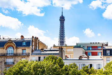 Eifel tower over the buildings in Paris downtown