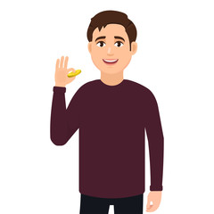 A young guy smiles and shows a gold coin. Vector illustration concept of businessman character holding up dollar coin.