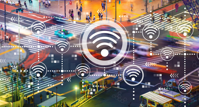 Wifi concept with busy city traffic intersection