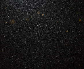 Snow flies in the sky at night as a background
