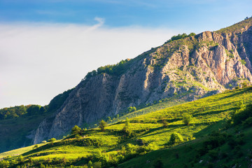 beautiful scenery of romania mountains at sunrise. distant cliff in morning light. wonderful travel background