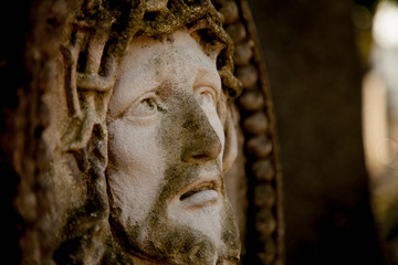 Fototapete - Ancient statue of the crucifixion of Jesus Christ in profile. Religion, faith, death, suffering, immortality, God concept.