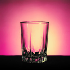 A glass of water on pink backgrounds
