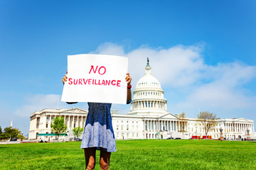 Protester holding in hands sign no surveillance
