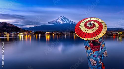 Wall mural Asian woman wearing japanese traditional kimono at Fuji mountain, Kawaguchiko lake in Japan.