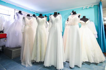 Large selection of beautiful wedding dresses in the salon