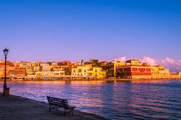 CHANIA, CRETE ISLAND, GREECE - JUNE 26, 2016: Stunning sunset view of the old venetian port of Chania on Crete island, Greece.