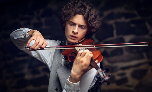 young violinist playing violin.