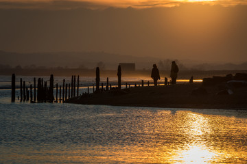 Silhouettes at sunset at Rye Harbour