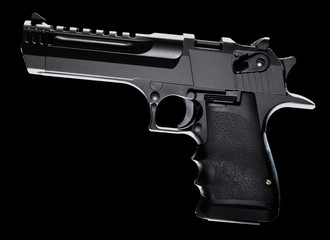 High powered pistol on black