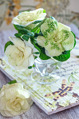 Beautiful bouquet of spring flowers in a vase on the table. Lovely bunch of flowers .Flowers of decorative cabbage.